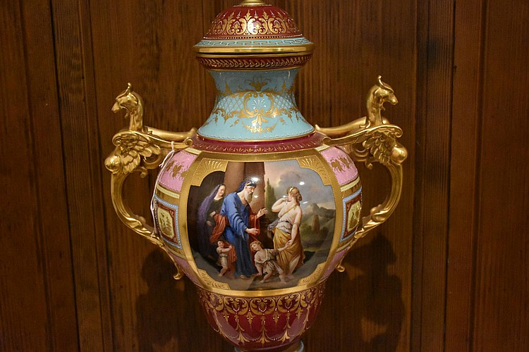 A museum quality Royal Vienna 19th century lidded large pedestal vase having superbly detailed hand painted panels of the classical scene, with winged gilt griffin handles. Height 84, width 38cms.