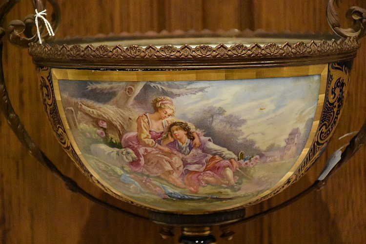 A wonderful 19th century French Sevres comport having fine ormolu mounts featuring the central panel depicting the courting couple. Height 37cm, Width 37cm