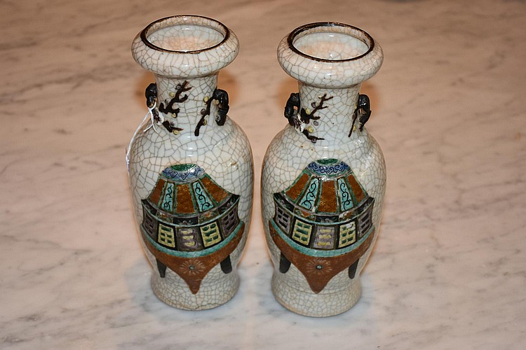 A pair of Chinese crackle glazed vases having hand painted symbol decoration, signed to base. Height 25cm, Width 11cm