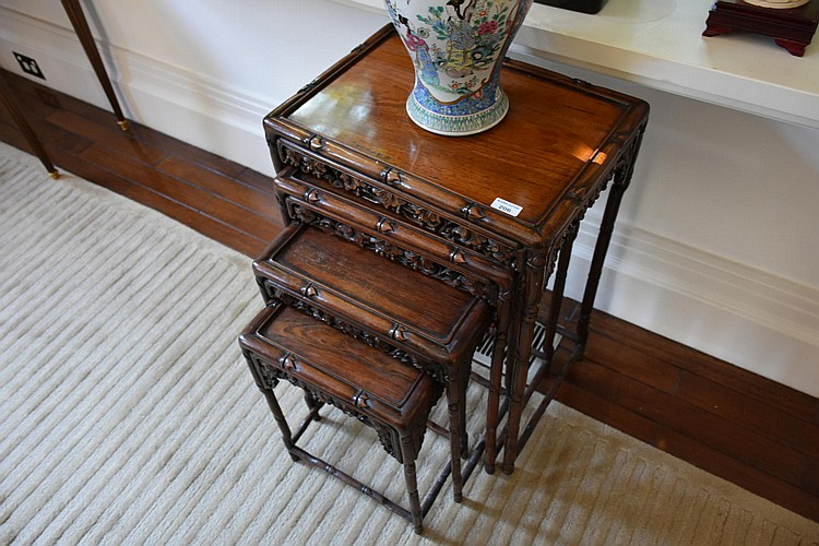 A fine Chinese set of four Cherrywood nest of tables, having faux bamboo decoration. Height 74cm, Width 52cm