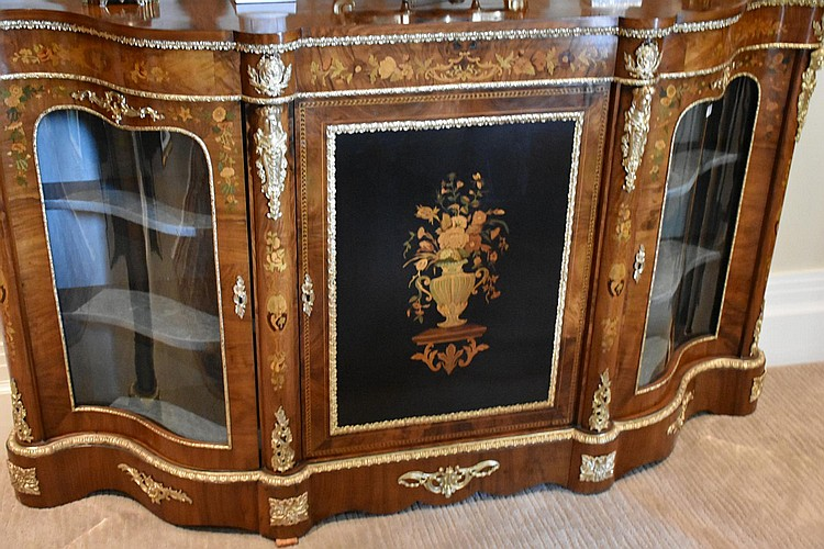 A wonderful French 19th century Burr walnut three door credenza, Having the finest floral marquetry inlay and lovely ormolu mounts. Height 111, width 192 cms.