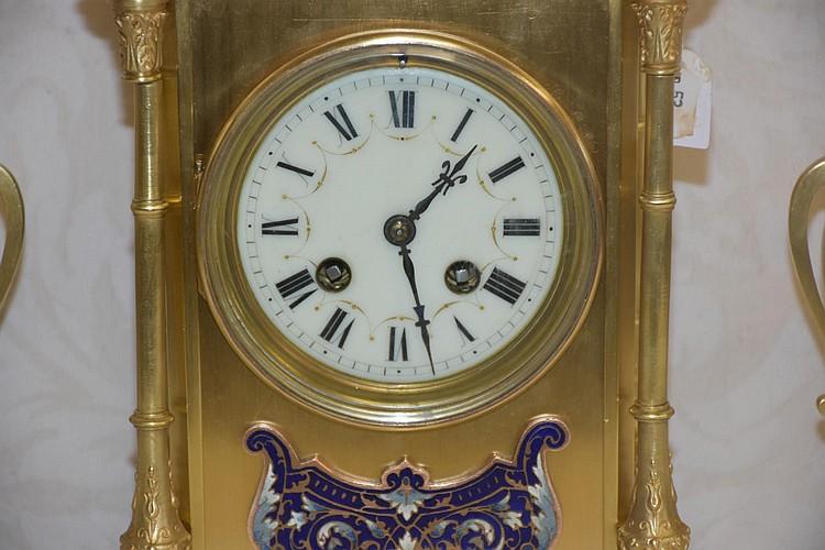 A fine quality French 19th century three piece clockset having fine champleve enamel decoration. Height 38cm, Width 20cm