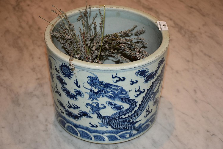 A nice large Chinese hand painted blue and white porcelain bowl with dragon decoration. Height 22, width 26cms.