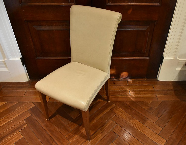 A set of six modern leather upholstered dinning chairs having scrolled back design. Height 90, width 43cms.