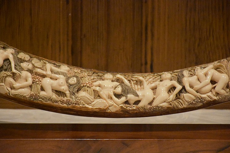 A finely detailed 19th century carved ivory tusk depicting erotic scenes. Height 24cm, Width 63cm
