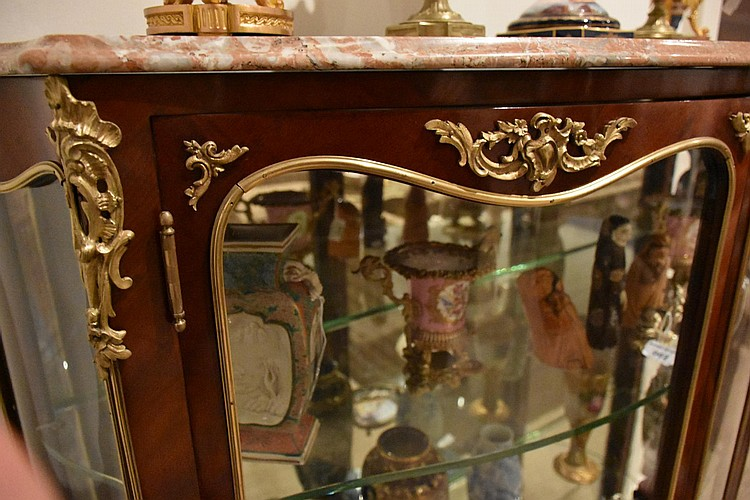 A superb French 19th century two door kingwood vitrine having fine ormolu mounts and fitted with a marble top. Height 151cm, Width 126cm