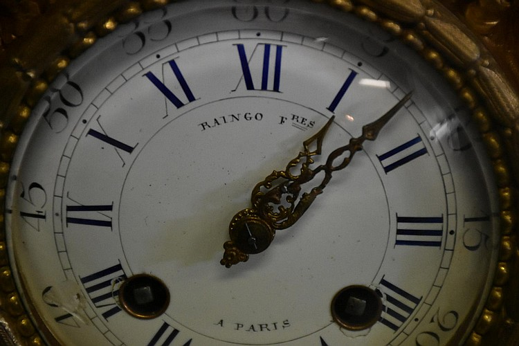 A fine quality French 19th century ormolu and bronze mantel clock having cherub decoration. Signed Raingo of Paris. Height 45cm, Width 50cm