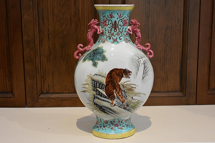 A Chinese hand painted porcelain temple vase having tiger and monkey detail. Height 30cm, Width 20cm