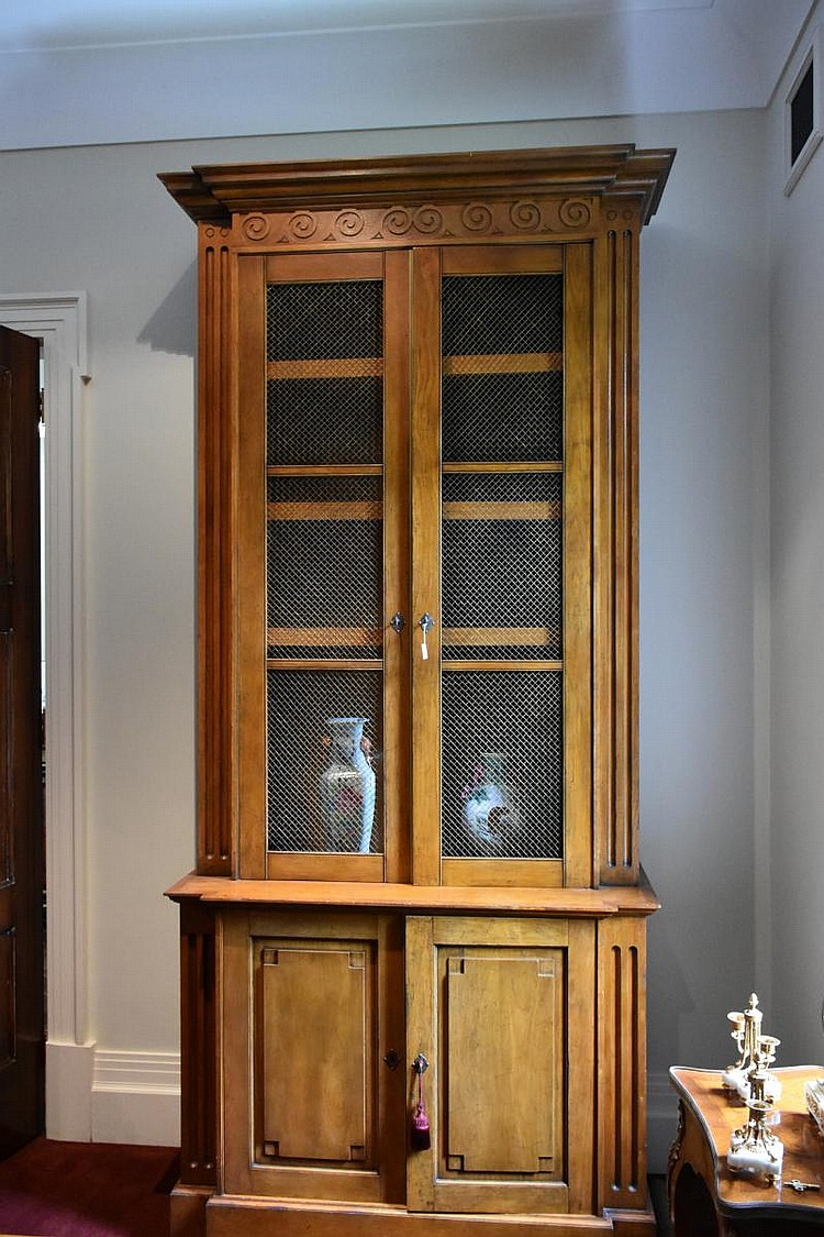 A good French provincial four door fruitwood bookcase having pierced brass detail. Height 300cm, Width 148cm