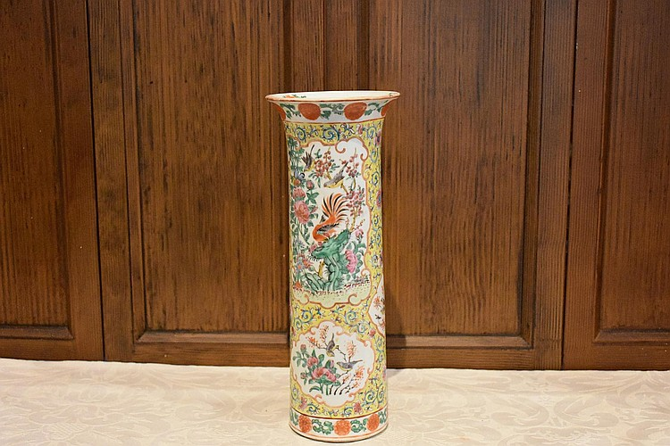 A Chinese hand panted cylinder vase having all over floral decoration. Height 34cm, Width 13cm