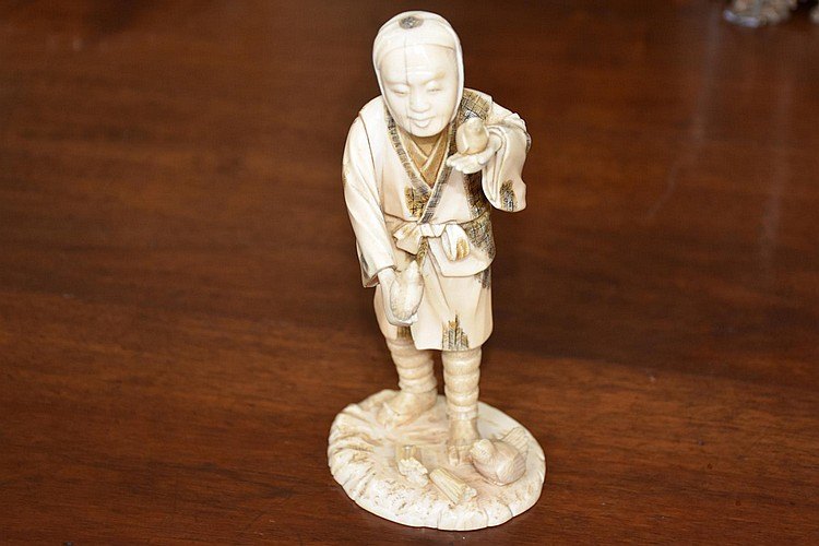 A good Japanese Meiji period okimono figure of the elderly gent with his birds, signed to the base. Height 21cm, Width 10cm