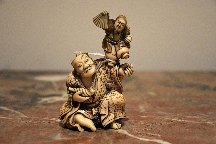 A finely carved Japanese 19th century ivory figure group of the playful children. Height 9cm, Width 5cm