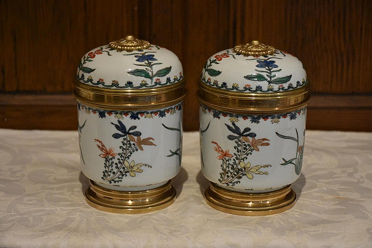 A fine pair of French 19th century Sevres lidded caskets having ormolu mounts and all over floral decoration. Height 15cm, Width 10cm