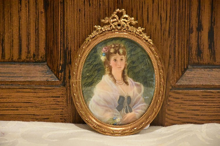 A signed miniature on ivory depicting the duchess in ormolu frame.