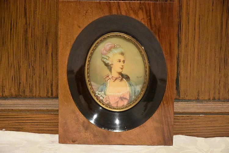 A good 19th century miniature on ivory in original walnut frame