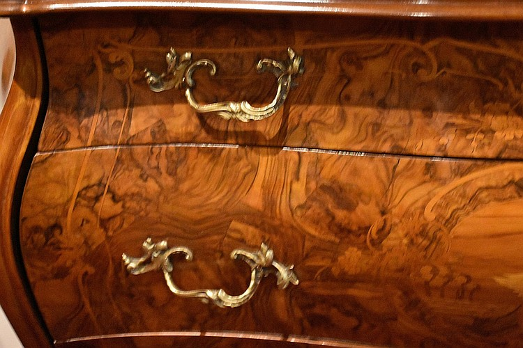 A most outstanding Continental three drawer burr walnut commode, having fine satinwood and fruitwood inlay and ormolu handles. Height 87cm, Width 133cm