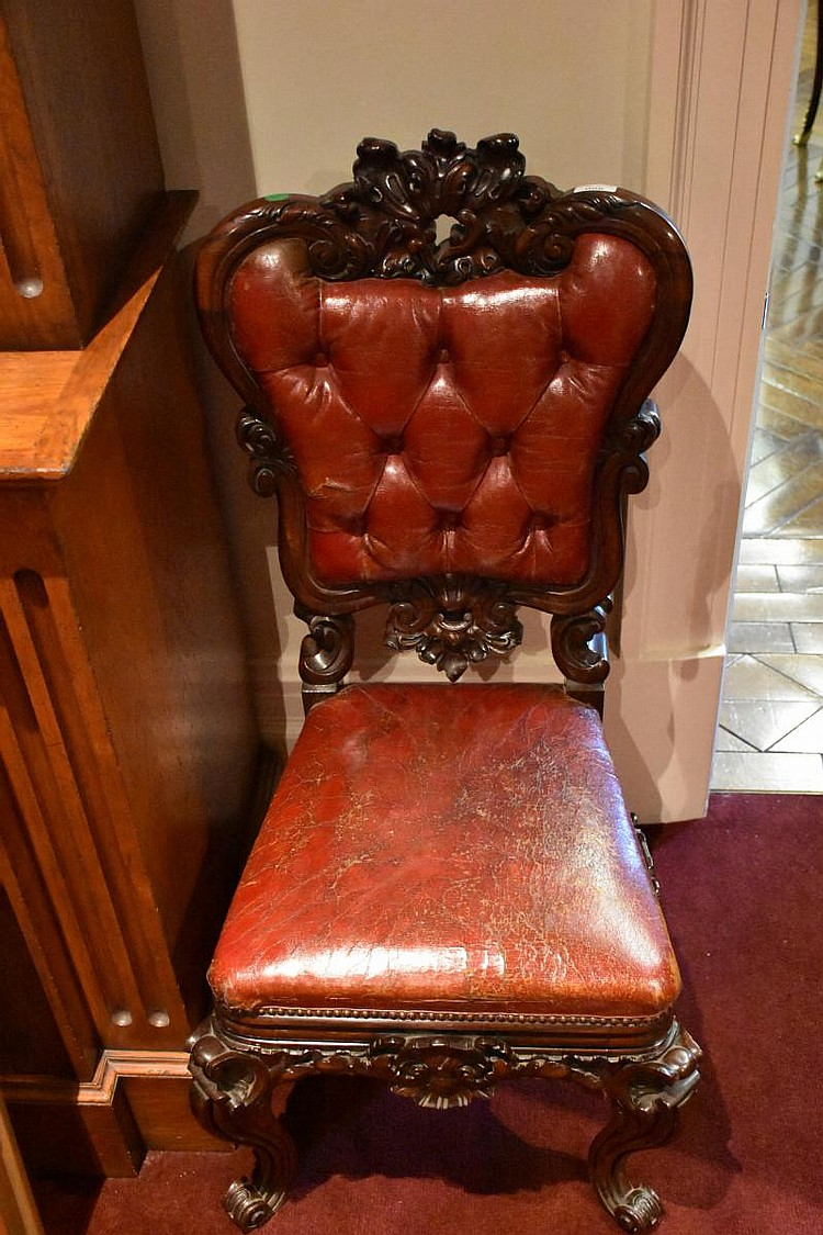 A good English Regency rosewood occasional chair having finely detailed floral carving and red leather diamond button upholstery. Height 101cm, Width 50cm
