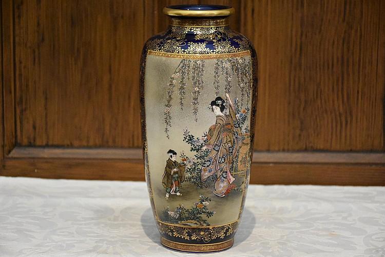 A good Japanese 19th century Satsuma vase having geisha and floral decoration. Height 26cm, Width 12cm