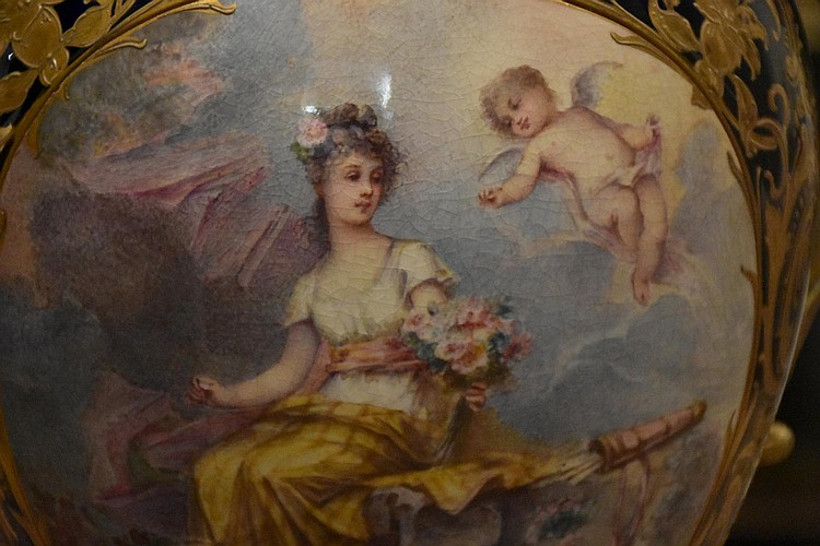 An exhibition French 19th century Sevres lidded vase having fine gilt highlights and superb ormolu mounts. The central panel depicting maiden with cherub. Height 71cm, Width 25cm