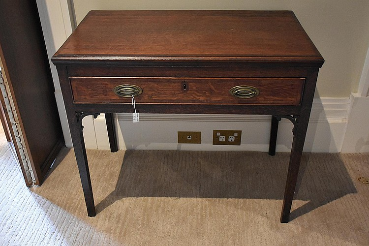 An early 19th century English oak single drawer hall table having cross banded decoration and brass handles. Height 71, width 83cms.