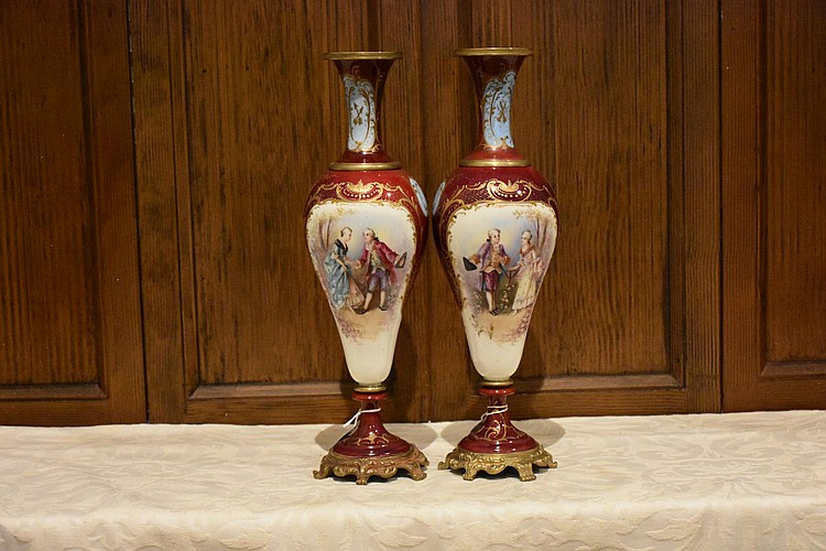 A lovely pair of French 19th century red ground Sevres and ormolu vases having all over hand painted decoration. Height 37, width 10cms.