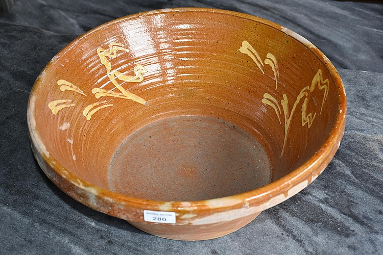 A pair of large terracotta outdoor bowls
