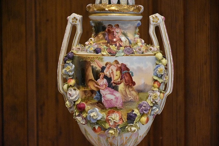 A superb pair of 19th century Meissen lidded pedestal vases having hand painted central panels of the courting scenes and raised floral decoration. Height 46cm, Width 14cm