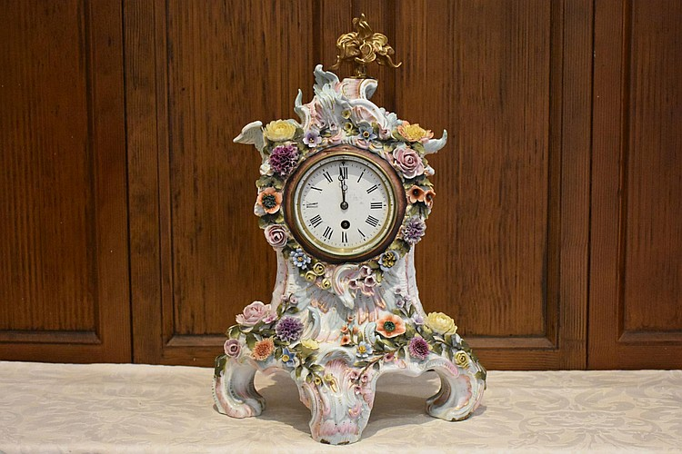 A good quality 19th century Meissen salon clock having all over raised floral decoration. Height 44cm, Width 27cm