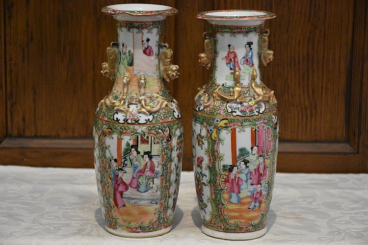 A fine pair of Cantonese 19th century cabinet vases having hand painted panels of the deity's and all over floral decoration. Height 26cm, Width 10cm
