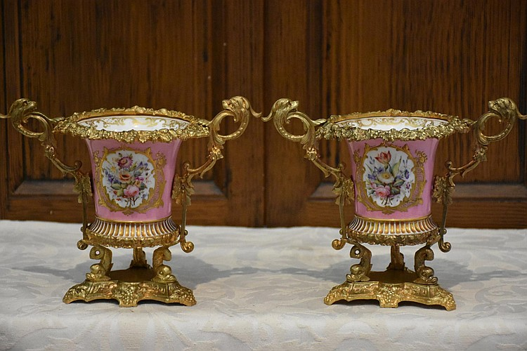 A superb pair of French 19th century pink ground Sevres urns having finely detailed ormolu mounts. Height 16cm, Width 21cm