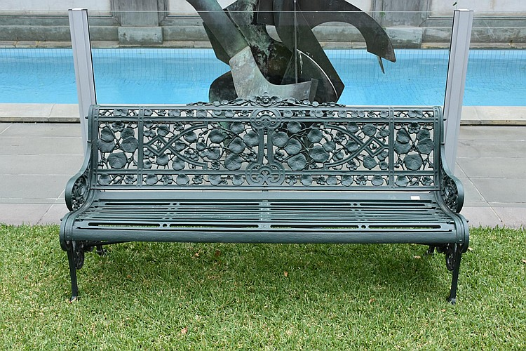 A fine large English Coalbrookdale outdoor garden bench having floral design, stamped by the maker. Height 83cm, Width 180cm
