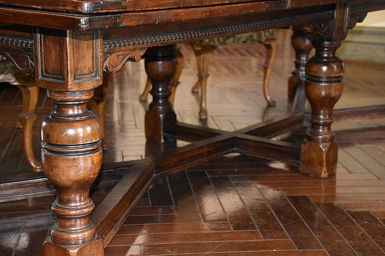 A superb English Charles II style extension dining table supported on turned legs and a stretcher base. Height 38cm, Width 306cm