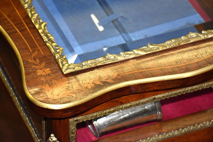 A fine French 19th century rosewood lift top display table, having satinwood inlay and all over ormolu mounts. Height 78cm, Width 62cm
