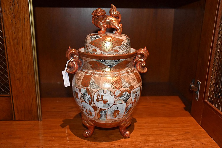 A Japanese 19th century Imari vase having all over hand painted decoration of the nobles. Height 33cm, Width 20cm
