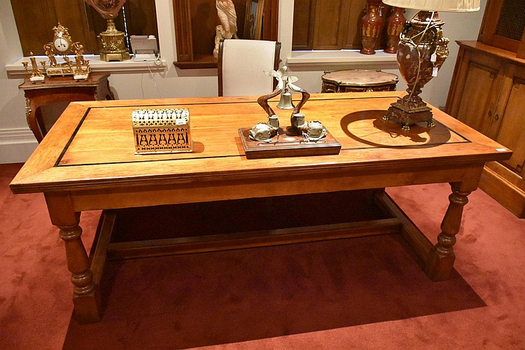 A superb French provincial walnut centre of the room bureau plat having ebon inlay and supported on a stretcher base. Height 78cm, Width 212cm