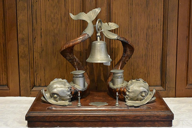An English 19th century carved horn and pewter desk set having fish detail and supported on an oak base. Height 34cm, Width 42cm