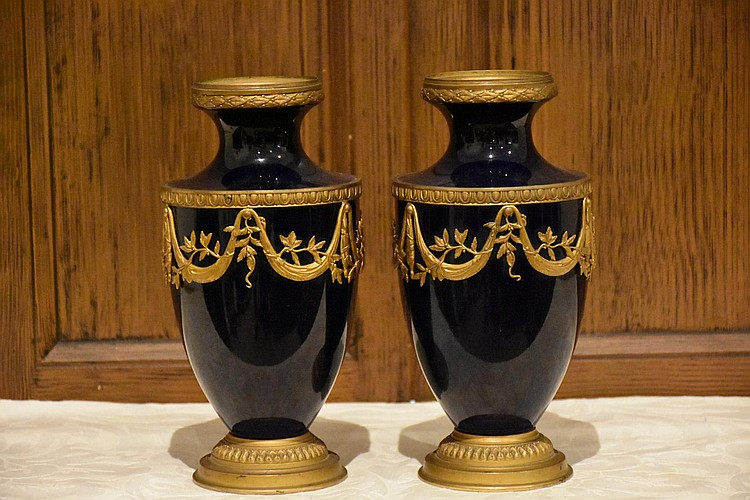 A lovely pair of 19th century Sevres cobalt blue vases having floral swag ormolu mounts. Height 23, width 11cms.