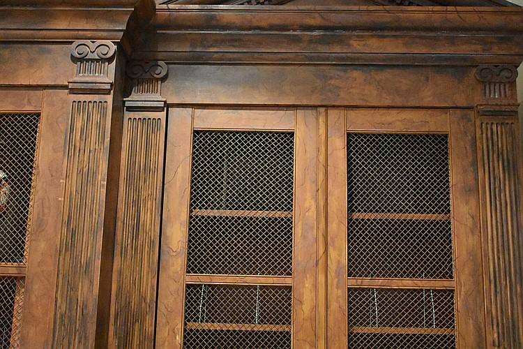 A fine architecturally designed library bookcase having carved pediments and fluted columns. Height 312, width 470cms.