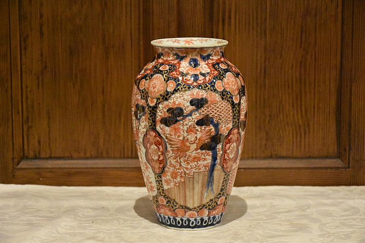 A ribbed Japanese Imari Meiji period vase with all over bird and floral decoration. Signed to base. Height 24, width 14cms.
