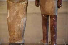 Two Egyptian Polychrome figures. One of mummified