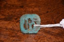An Egyptian 18th Dynasty Pierced Faience Amulet