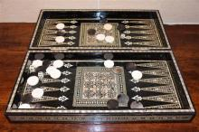 An Egyptian mother of pearl inlayed chess board