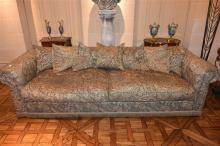 A large down filled two seater settee