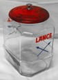 Glass Lance display jar with nice label, some rust on lid