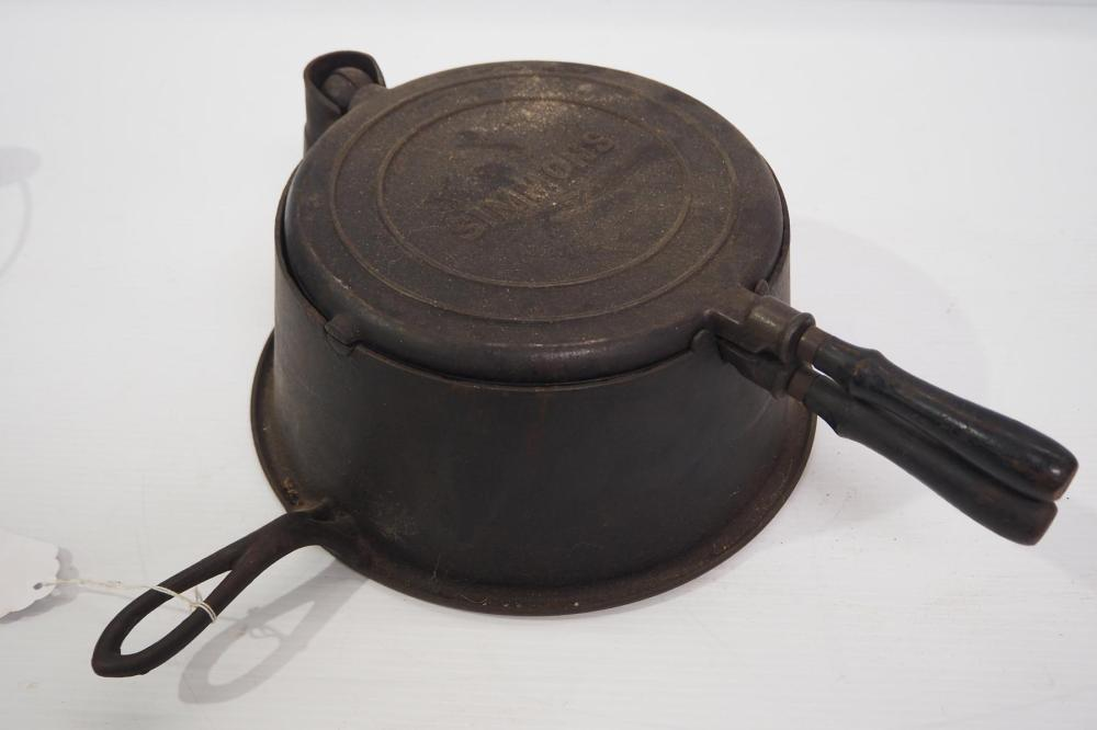 Simmons waffle iron with Simmons logo