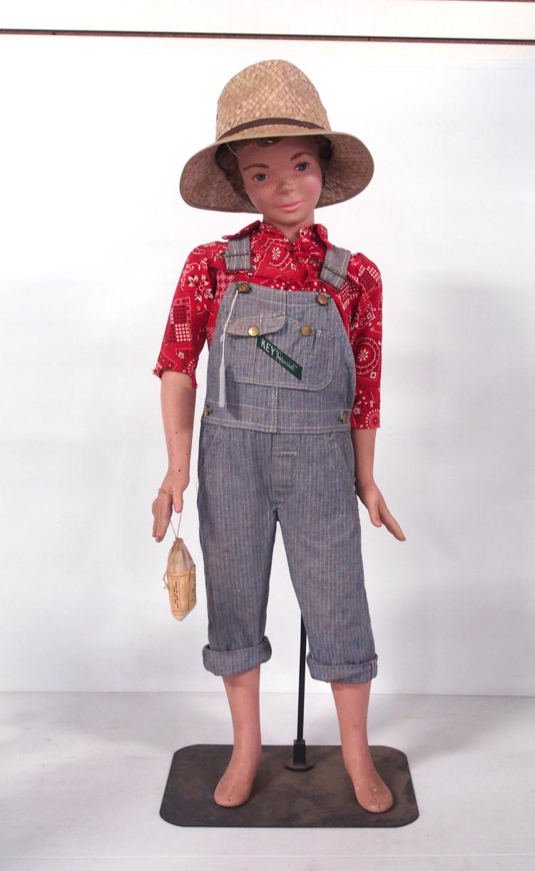 mannequin dressed in farm clothes