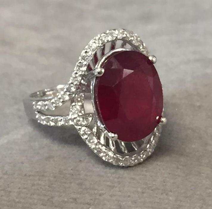 Ruby & diamond ring set in 14kt white gold, Size 6, Ruby 7.70ct; Diamonds .63ct $6,000.00 A.I.G. app