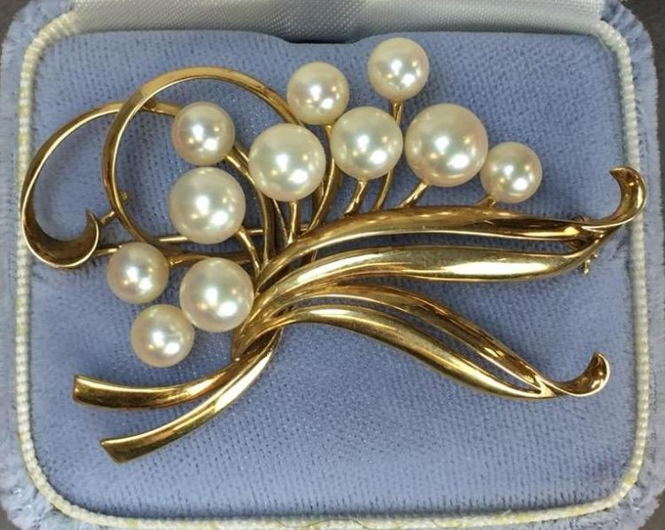 14k Gold and Mikimoto Pearl brooch w/ $7,285.00 A.I.G. appraisal.