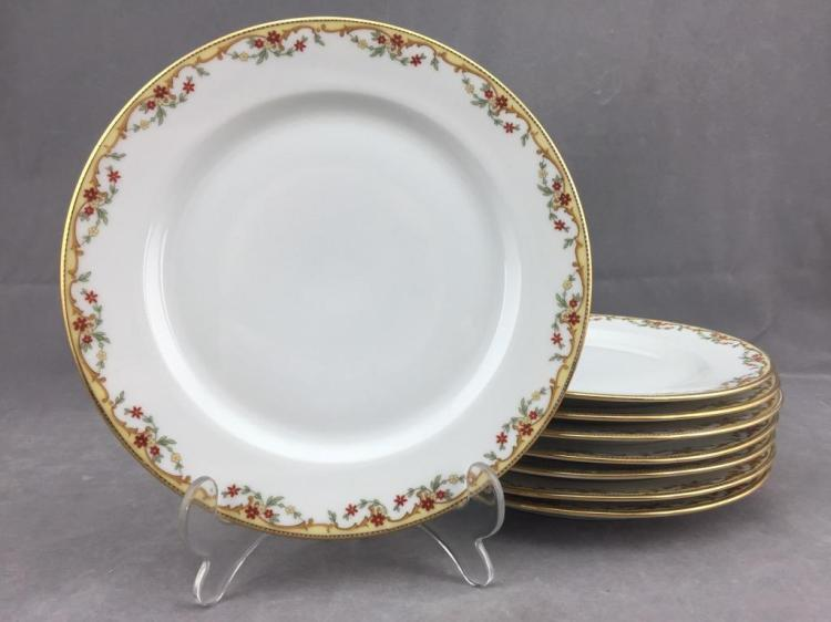 (8) Vignaud Limoges porcelain dinner plates w/ gilded floral design