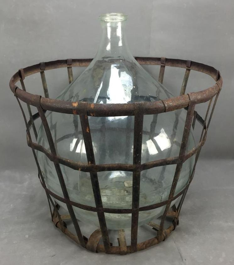 Antique French blown glass demijohn in wire carrier